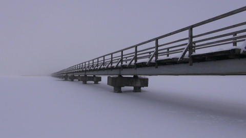Bridge through frozen lake Footage