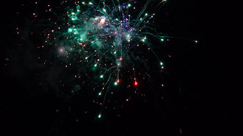 Fireworks exploding in various colors Image