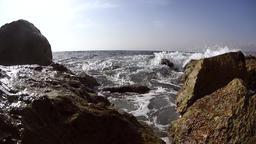 Waves splashing over wavebreaker Footage