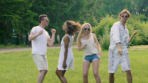 Four young active friends enjoying summer dancing together, extra-slow motion Footage