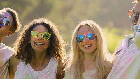 Young friends hanging out at open-air Holi festival, dancing full of euphoria Footage
