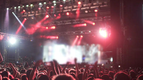 Energetic crowd of fans jumping at music festival, impressed by rock star show Live Action