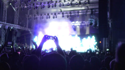 Music fans recording video of amazing performance on gadgets, concert slow-mo Footage