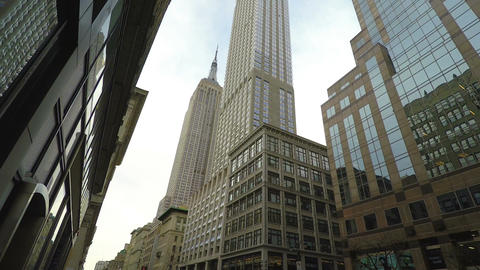 New York, USA The Empire State Building low angle street view Footage