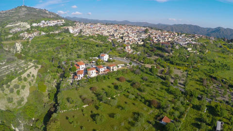 Large resort city situated on lush green hills surrounded by mountain range Footage