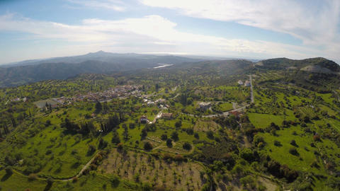 Cozy village surrounded by green landscape with clean air and many trees, aerial Footage