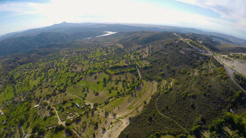 Birds eye view of beautiful green mountain landscape in Cyprus, blue sky horizon Footage