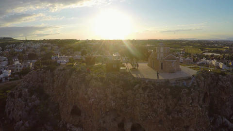 St Elias Church standing on rocky hill in Protaras, Cyprus landmark aerial view Footage
