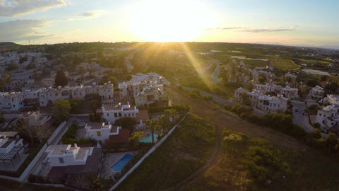 Luxury apartment buildings in environmentally clean area of Cyprus at sunset Footage