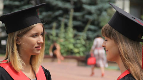 Female friends graduates discussing future holidays, friendly conversation Footage