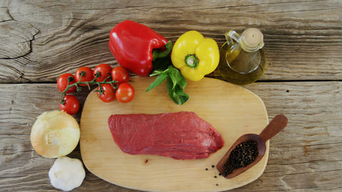Sirloin meat loaf and ingredients on wooden board Footage