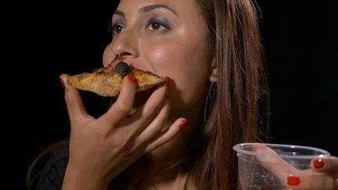 Woman looking satisfied eating delicious pizza and drinking cola soda Footage
