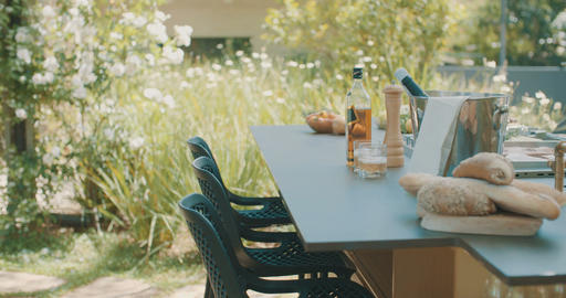 Tracking shot of a luxury outdoor kitchen in a large backyard Footage