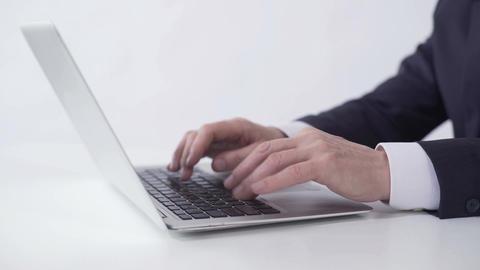 Hands of successful businessman typing on laptop, working on project report Footage