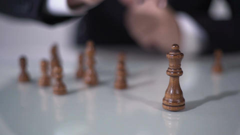 Man making winning queen move in chess game, using successful business strategy Footage