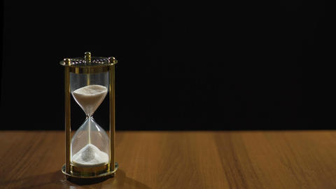 Sandglass measuring time by sand flow, life passing quickly, time management Live Action