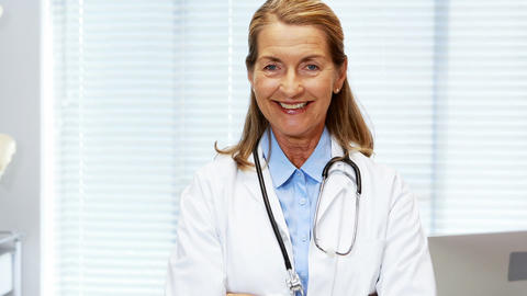 Portrait of female doctor standing with arms crossed Stock Video Footage