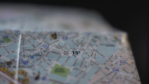 Close up of French city map, hand of tourist marking trip destination with pin Footage