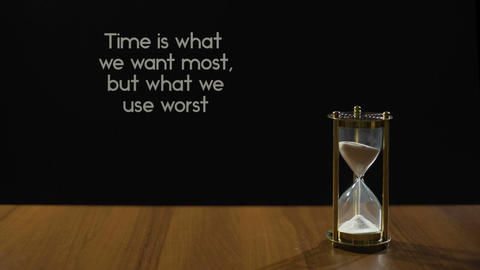 We want time most but use worst, time management, sand flowing in hourglass Live Action