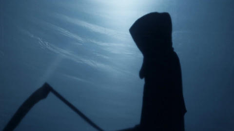 Grim Reaper silhouette preparing sharp scythe to collect victim, fear of death Footage