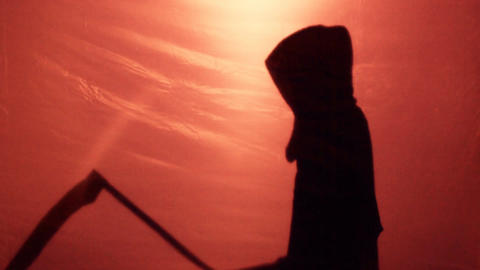 Ominous Grim Reaper silhouette came to take murdered victim soul, scary thriller Live Action