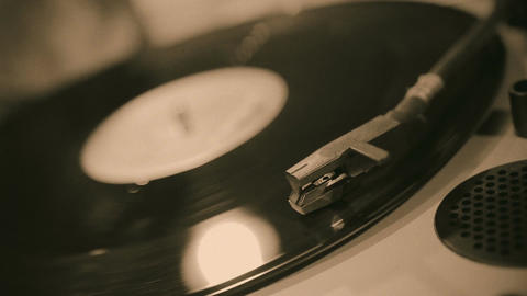 Turntable stylus closeup, retro music playing on vinyl record, sound equipment Footage