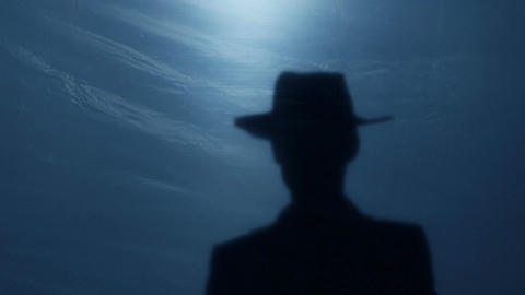 Silhouette of brave wild West sheriff tipping his hat to gangster before duel Footage