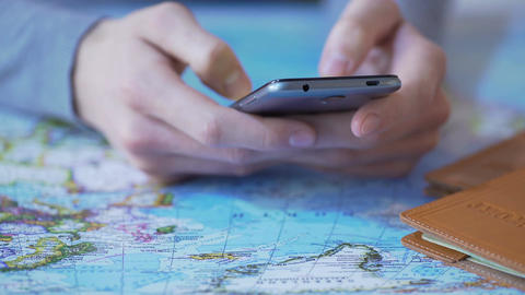 Man using travel app on smartphone, buying tour and booking tickets online Footage