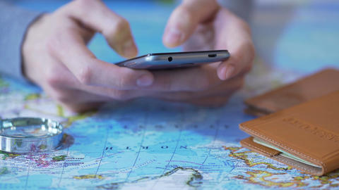 Tourist viewing mobile app on gadget to book tickets and hotel room for vacation Footage