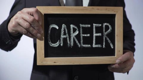 Career written on blackboard, business person holding sign, motivation, future Footage
