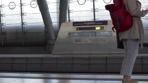 Frankfurt Airport Train Station Travelers Walk Past Sign Filmmaterial