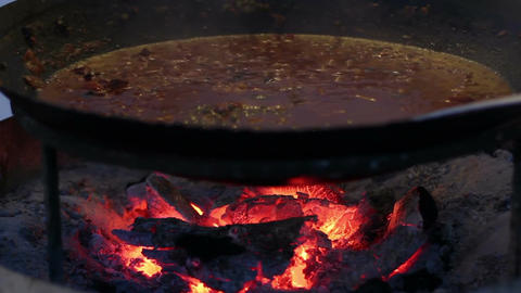 Cooking Food On The Fire In The Cauldron Footage