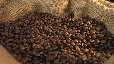 Video of rotating coffee beans linen sackful in 4K Footage