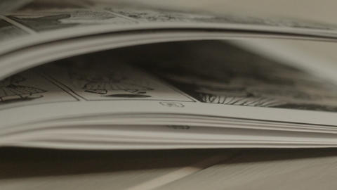 Close up of fliping comic book pages Footage