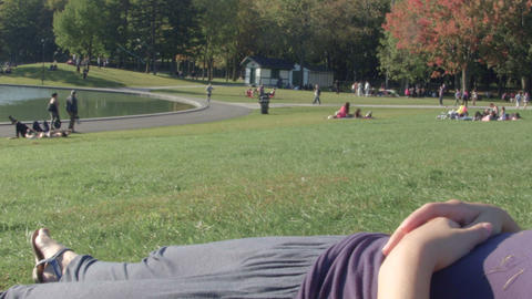 Asleep woman body in a Park Footage