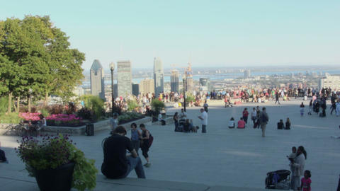 Crowd of tourists contemplating Montreal Cityscape Live Action