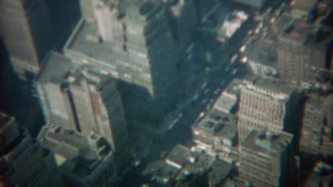 1968: Atop a skyscraper looking down to the car street traffic below Footage
