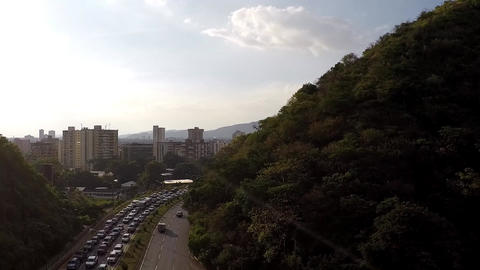 Highway Traffic Congestion Buildings And Mountain View 03 stock footage
