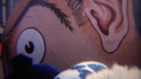 1967: Creepy balloon parade float character carried through downtown Footage