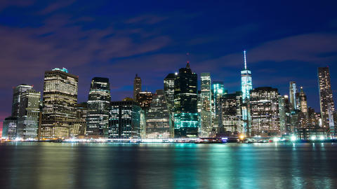 Lights of the Skyscrapers are Lighting Up on Manhattan. Time Lapse Footage