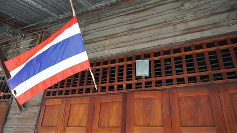 Thai flag hanging above door home Footage