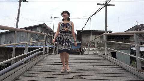 Walk in crossing the wooden bridge Footage