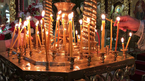 candlesticks with burning candles in a Christian Orthodox church ビデオ