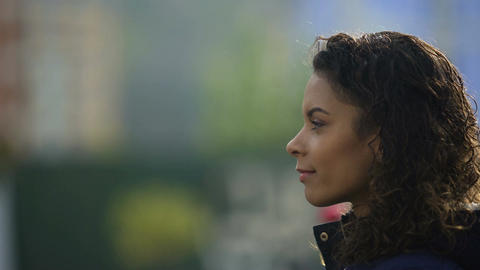 Beautiful biracial young lady portrait in profile, inspired woman model smiling Footage