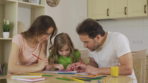 Happy family painting together, loving parents enjoying leisure with daughter Footage