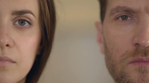 Male and female half face looking into camera, gender equality, opinion poll Live Action