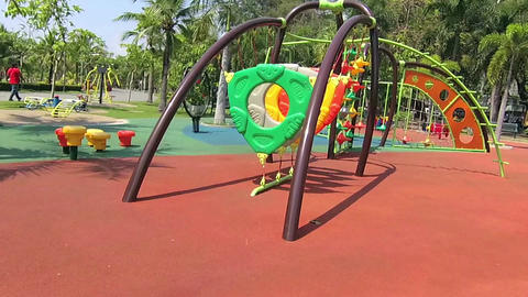 Run to the playground in public park at sunny day Footage