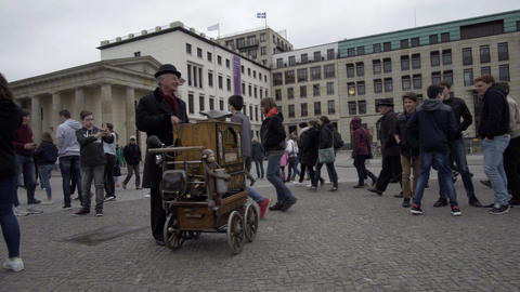 Berlin Germany Brandenburg Gate Square Man Plays Street Organ Handheld Footage