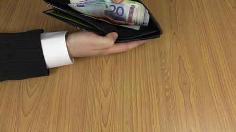 man in suit open black leather wallet with euro banknotes. 4K Footage