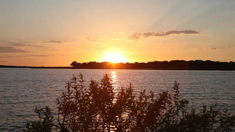 Vibrant orange sunset on Grapevine Lake Image